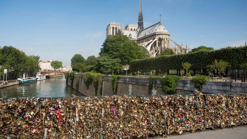 Love locks hooked to a bridge near the Notre Dame Cathedral. (AFP)