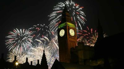 The London skyline dark against a colourful pyrotechnics display. (AAP)