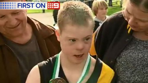 Twelve-year-old Alec with his parents after the game. (9NEWS)