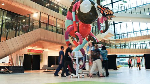 A patient is transferred through Main Street at the Royal Children's Hospital in Melbourne. (AAP)