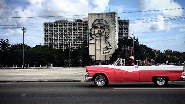 A classic American car passing through Revolution Square. (Laura Turner)