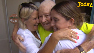 When Norm saw his granddaughter he quickly pulled his family into a hug.