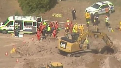 Excavators worked for more than two hours to free the trapped worker. (9NEWS)