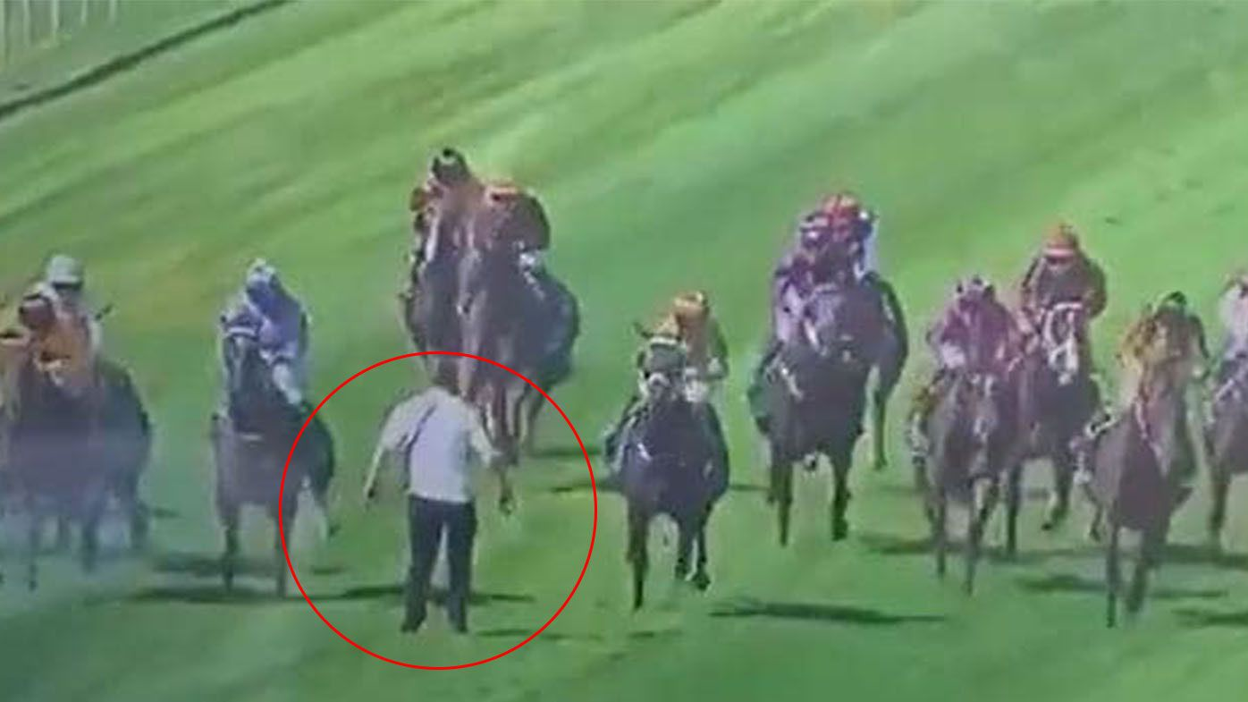 Idiotic punter storms Trentham Racecourse mid-race, putting himself, jockeys, horses at huge risk