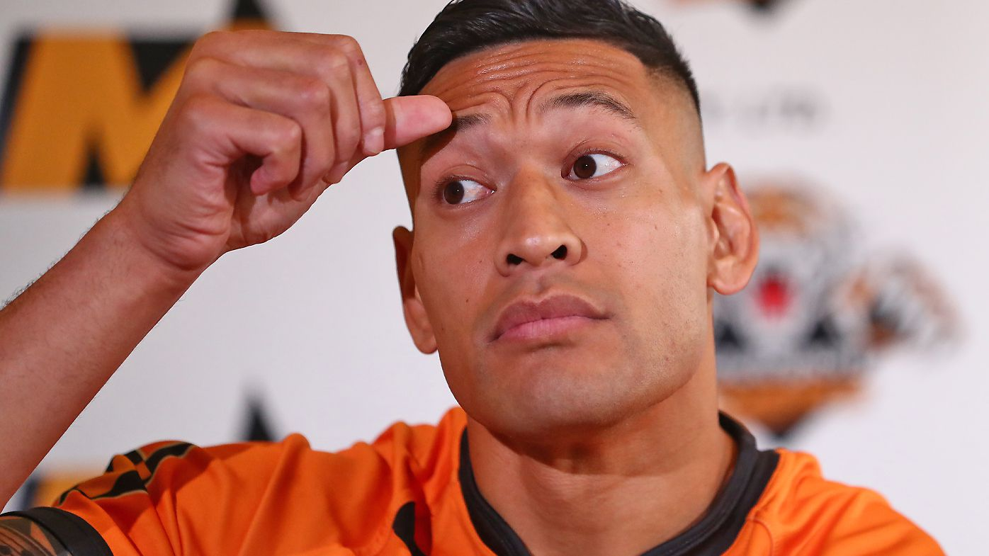 Israel Folau speaks to the media during a press conference