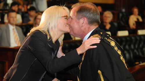 Lord Mayor Doyle kissing wife Emma Campbell after being sworn in . (AAP)