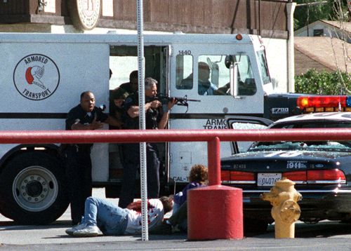 LAPD officers shield injured civilians across the street from the Bank of America in North Hollywood.