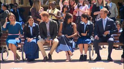 The royal touch: Meghan matches outfit to uniforms in school visit