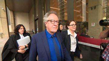 Geoffrey Rush arrives in court.