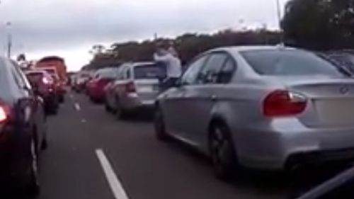 At one point, the man in the blue shirt had the man wearing the white shirt in a headlock (Dash Cam Owners Australia)