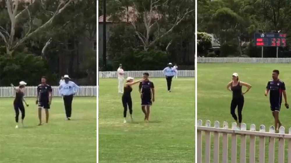 Woman sprays cricketers.