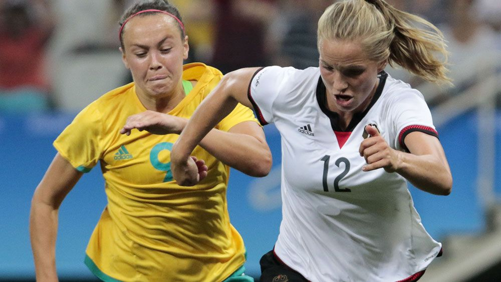 Caitlin Foord tries to stop a German rival. (AFP)