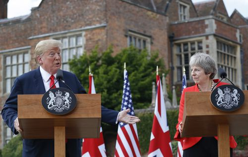 Mr Trump and Mrs May put on a happy face, but the president's UK trip has been marred by protests and incendiary newspaper interviews he has given. Picture: AAP