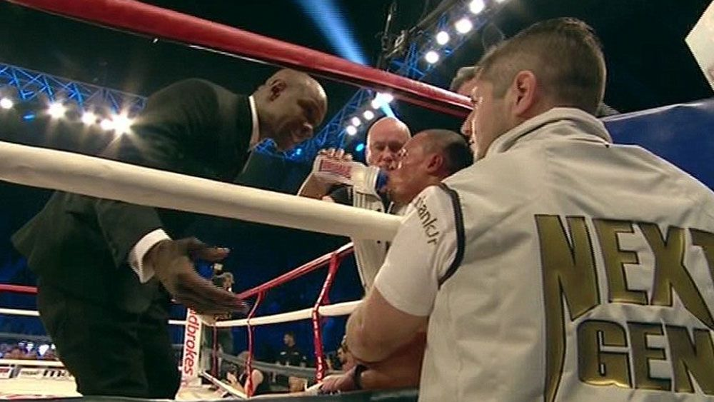 Boxer's father tries to protect opponent