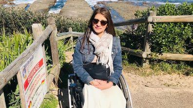 Ameeta MS in a wheelchair