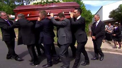 Thousands line Macksville streets to mourn 'local hero'