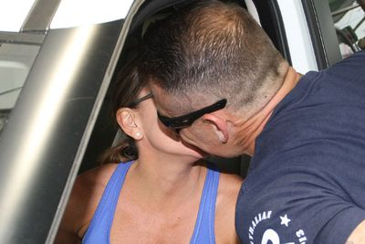 The romance between Michelle Bridges and Steve 'Commando' Willis seems to be going full steam ahead, judging by the latest pics obtained by TheFIX. <i>The Biggest Loser Australia</i> trainers were photographed sneaking in a pash around lunchtime today, Friday, November 8, at Sydney Airport. <br/><br/>Michelle dropped Commando off for his flight to Perth. It's great to see these two so happy!<br/><br/>Images: INF Photo