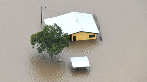 Houses are inundated with flood waters in Ingham. (AAP)