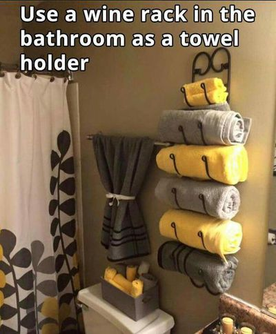 <strong>Use a wine rack as a towel holder</strong>