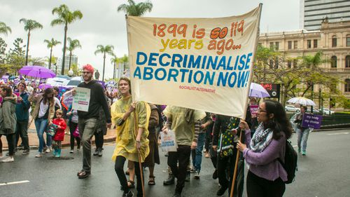 People are seen attending the March together for Choice rally in Brisbane last weekend.