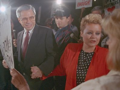 Jim Bakker and wife Tammy Faye Bakker greet supporters as they leave federal court in Charlotte.