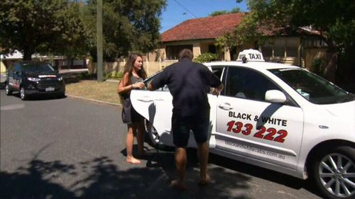 A woman is dropped off at the property today. (9NEWS)