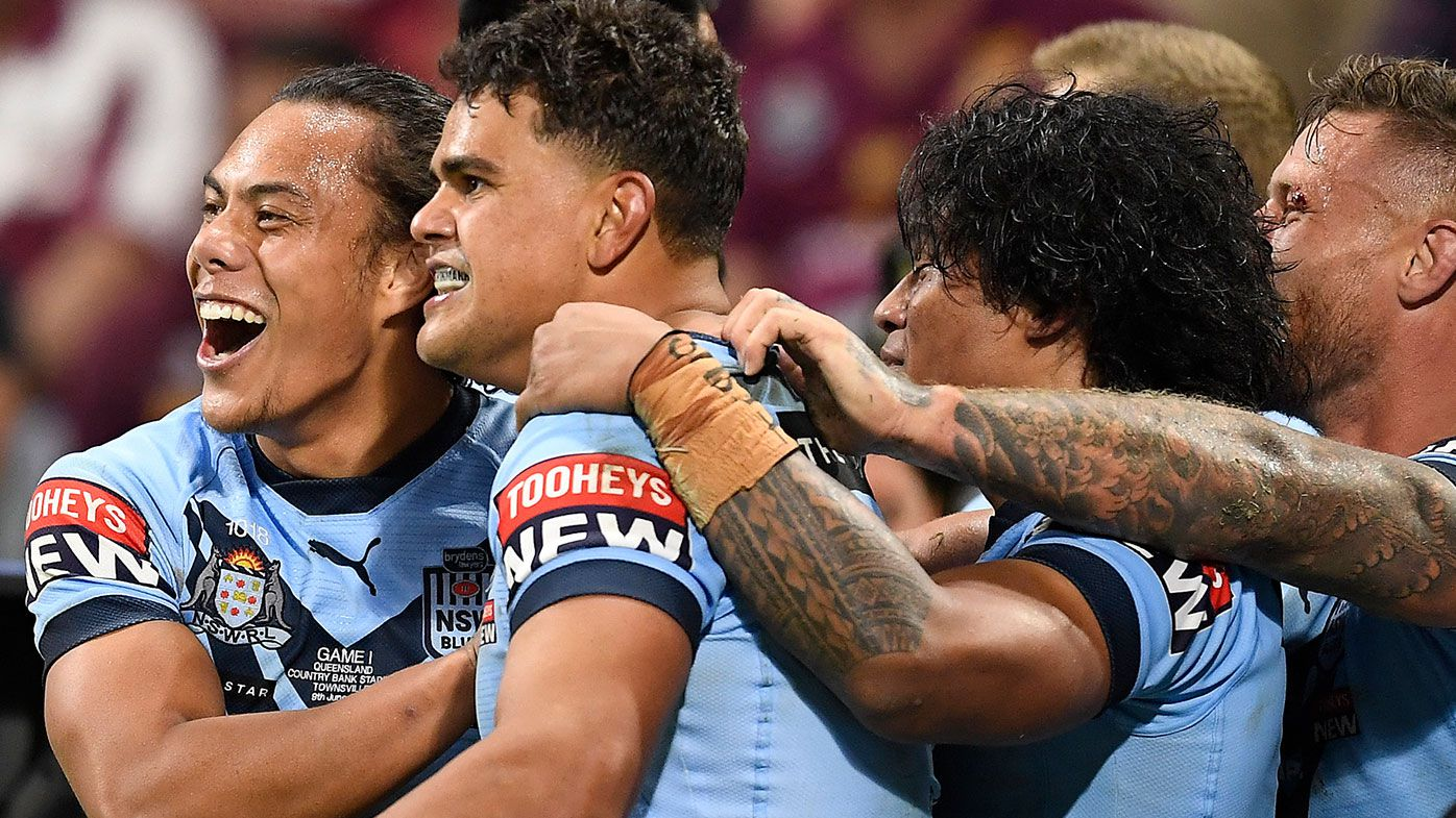 Latrell Mitchell of the Blues celebrates with team mates after scoring a try during game one of the 2021 State of Origin series between the New South Wales Blues and the Queensland Maroons at Queensland Country Bank Stadium on June 09, 2021 in Townsville, Australia. (Photo by Ian Hitchcock/Getty Images)