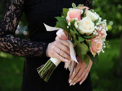 Goth bride holding flowers