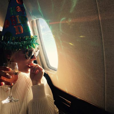 Two planes, 12 BFFs...and some vino. We guess those pregnancy rumours aren't true, then?