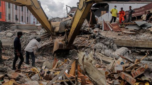 Rubble continues to hamper search efforts. (AFP)