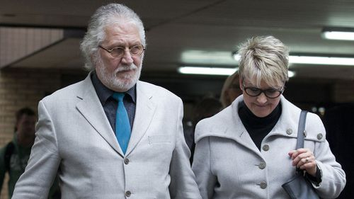 The ex-Top Of The Pops presenter was found guilty of the indecent assault of a female researcher who was working on the Mrs Merton Show in January 1995. He is pictured leaving court with his wife. (AAP)