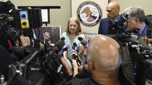 Cindy Evans, a friend of murder victim Pamela Maurer, speaks to the media following a news conference in Wheaton, Illinois.