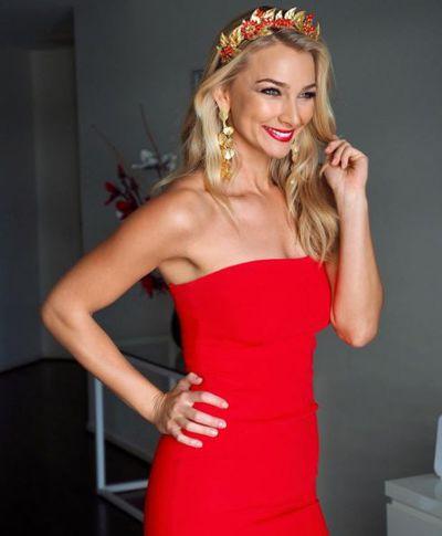 Anna Heinrich in a Cinq a Sept dress dress and Viktoria Novak crown