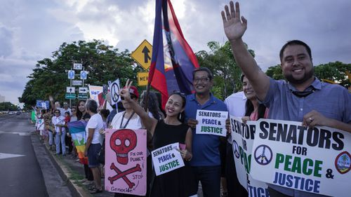 """Members of community groups calling for the """"de-colonization and de-militarization of Guam"""" attend a """"People for Peace"""" rally in Hagatna on August 14, 2017. (AFP)"""