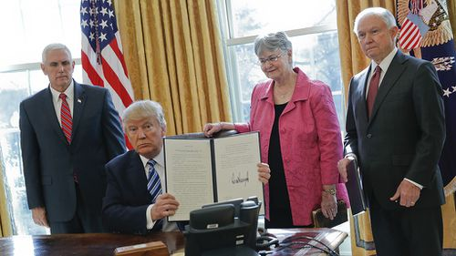 Trump signs executive orders giving police more authority declaring a 'new era of justice'
