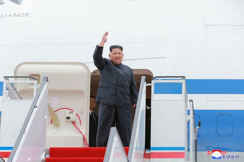 North Korean leader Kim Jong-Un waves as he leaves for Singapore.