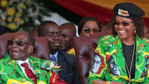 Robert Mugabe and his controversial second wife Grace. (Photo: AP).