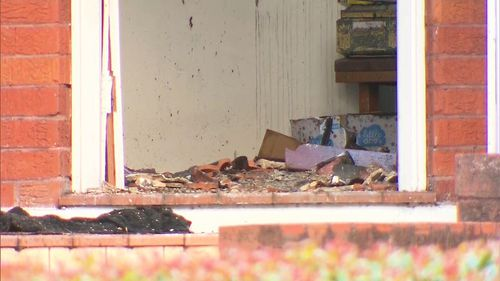 The interior of the home has been reduced to a smouldering rubble.
