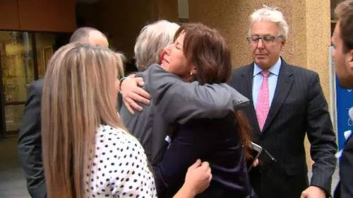 Ms Rowley's family outside the Coroner's court today. (9NEWS)