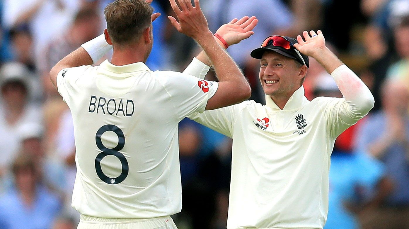 Root and Broad celebrate a wicket during the first Ashes Test