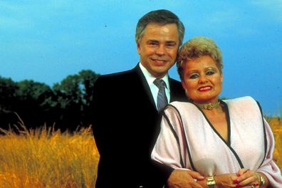 Former televangelists Jim and Tammy Faye Bakker standing in the middle of a wheat field.  (Photo by Will And Deni McIntyre/Getty Images)