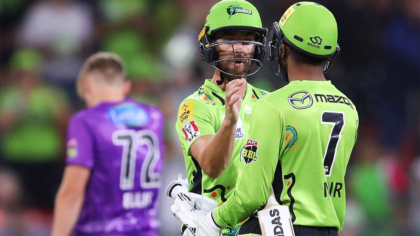 Alex Ross and Arjun Nair of the Thunder celebrate victory during the Big Bash League match