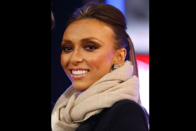 Giuliana Rancic rugged up against the winter chill in Times Square, New York. With her sleek ponytail and dazzling smile, her recent health concerns seemed a thing of the past (the presenter has been through a very public breast cancer battle this year)... here's to a happy, healthy 2012 for Giuliana.