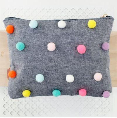 "<a href=""https://www.pavementbrands.com/item/015201-pom-pom-pencilcase.html?colour=assorted"" target=""_blank"" draggable=""false"">Pavement Pom Pom Pencil Case, $16.95.</a>"