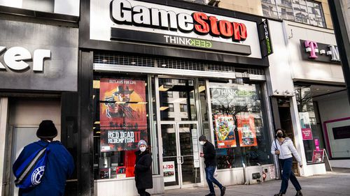 Pedestrians pass a GameStop store on 14th Street at Union Square, New York.