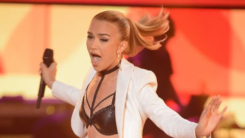 Ex-Hi-5 star Fely Irvine goes out with a bang on The Voice... in a sizzling-hot leather bra!