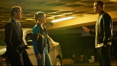 The crime thriller also stars Joel Kinnaman (right), alongside Rosamund Pike (centre), Common and Clive Owen (left).