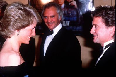 Princess Diana attends the premiere of the film Wall Street. Pictured here meeting American actor Michael Douglas, 27th April 1988