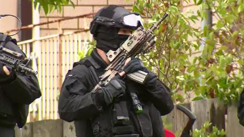 Officers from the Special Operations Group were on standby throughout the 12-hour siege. (9NEWS)