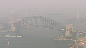 Sydney's iconic Harbour Bridge is still blanketed by a thick smoke haze as several fires burn across NSW.